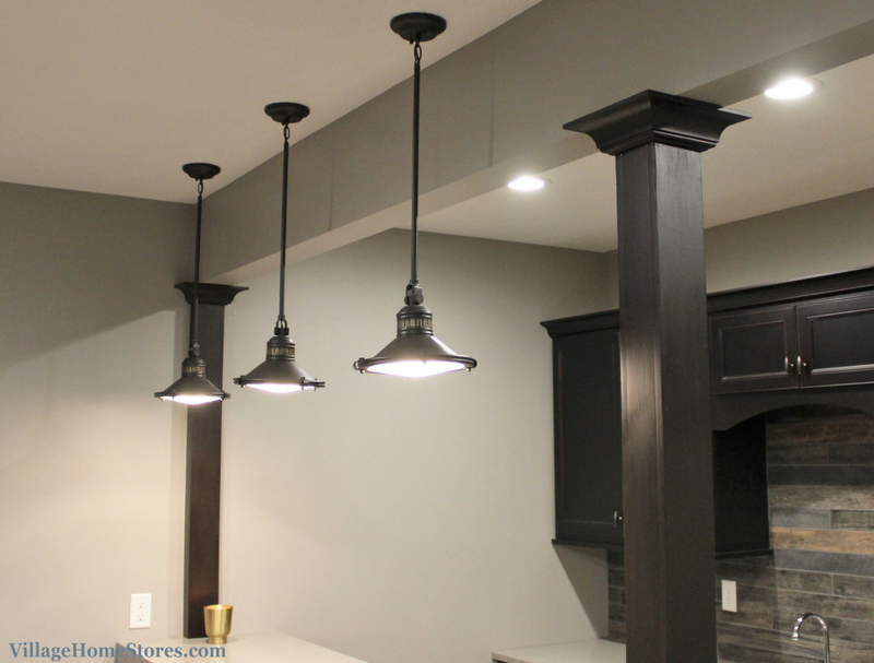 Kichler pendant lights hang in a home bar in a Coal Valley, IL built by Hazelwood Homes. | VillageHomeStores.com