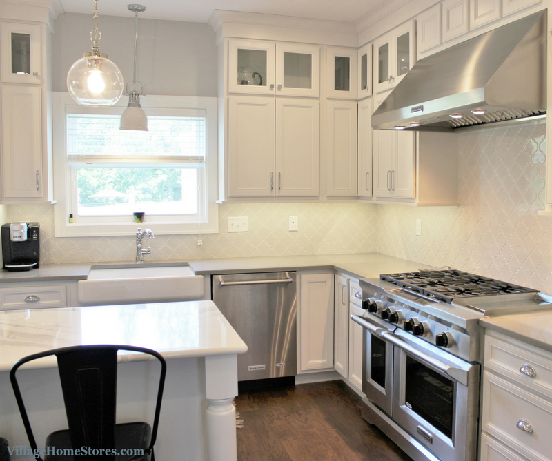 White painted kitchen in a Coal Valley, IL with farmsink and KitchenAid appliances. Home by Hazelwood Homes. -VillageHomeStores.com