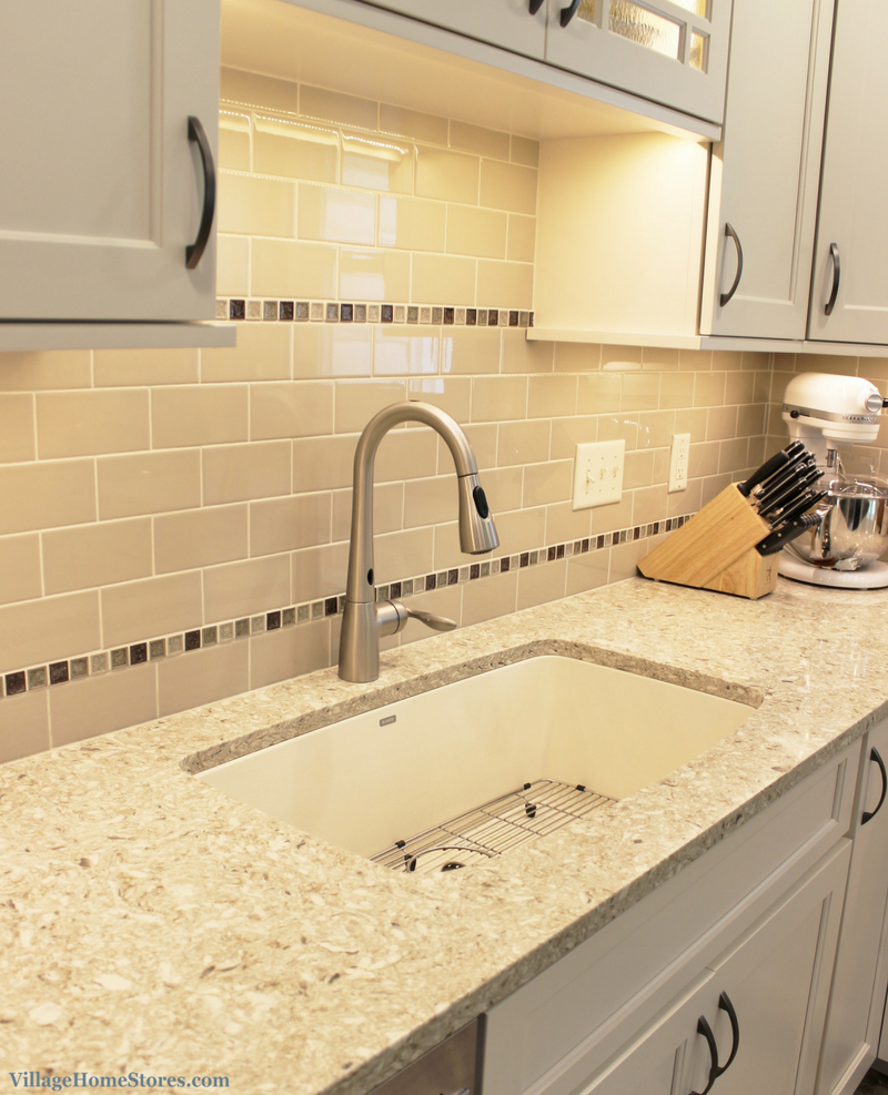 A Rock Island, IL kitchen with tiled space above sink. | VillageHomeStores.com