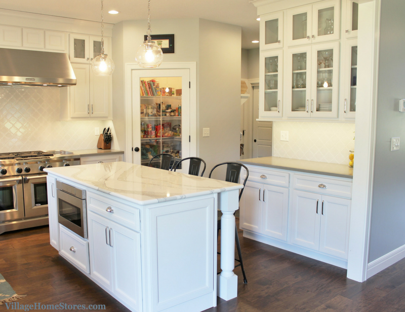 White painted transitional farmhouse style kitchen in a Coal Valley, IL. home built by Hazelwood Homes. | VillageHomeStores.com