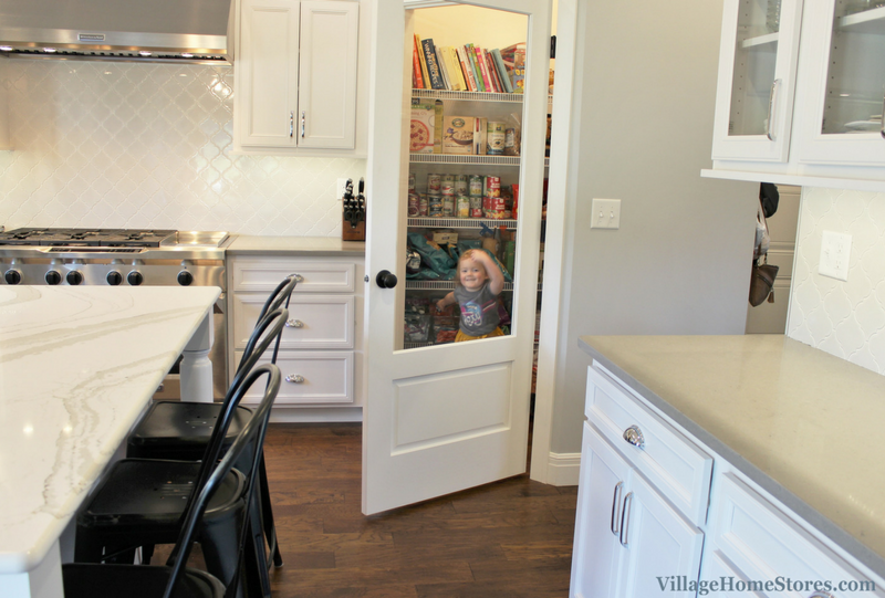 Transitional farmhouse kitchen in a Coal Valley, IL with glass door corner pantry. | VillageHomeStores.com