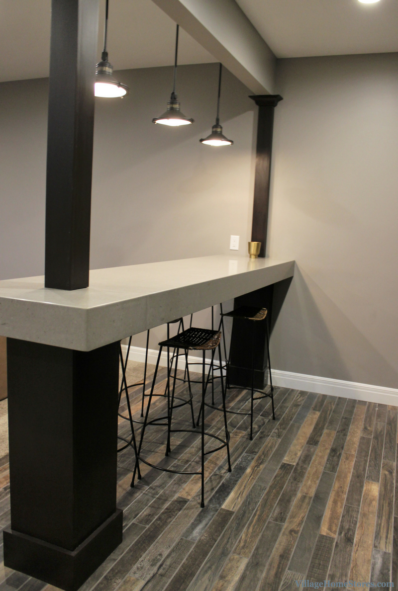 Unique home bar design in a Coal Valley, IL with suspended bar top look. | VillageHomeStores.com