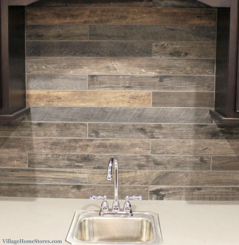 Wood look tile backsplash in a Coal Valley, IL home by Hazelwood Homes. | VillageHomeStores.com