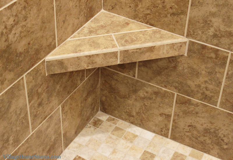 Custom tiled shower with corner bench in Moline, IL bathroom. | VillageHomeStores.com