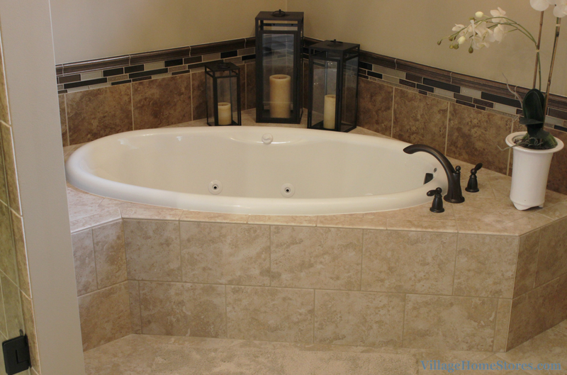 Tiled corner tub surround in Moline, IL bathroom. | VillageHomeStores.com