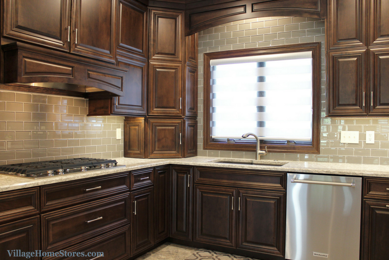 Birch Mocha kitchen in Geneseo, IL with glass subway tile as backsplash and above sink. | VillageHomeStores.com