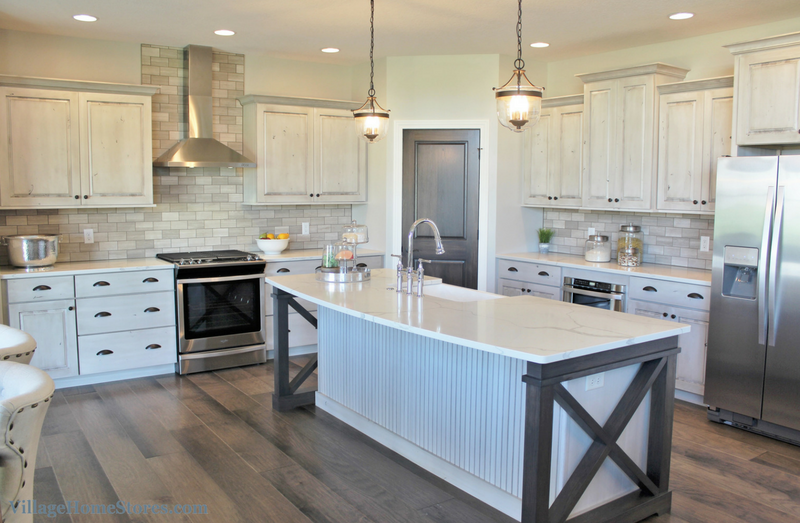 White Drift painted kitchen with Gray Stone stained accents. Kitchen in a Bettendorf, IA with design and materials by Village Home Stores for Aspen Homes LLC. | VillageHomeStores.com
