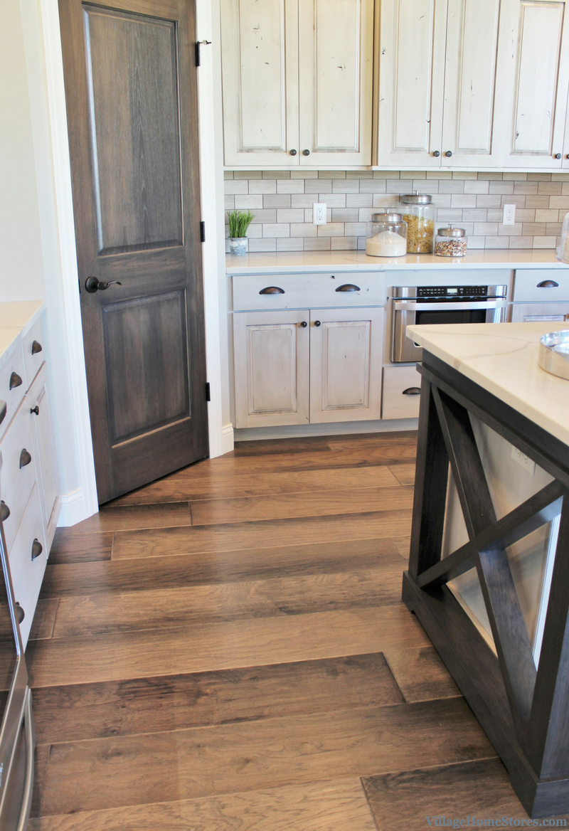 Painted cabinets paired with cerused hickory finish pantry door and island details. | VillageHomeStores.com