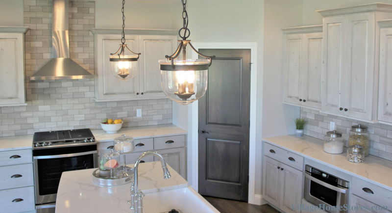 Kitchen island lights by Capital Lighting in a Bettendorf, IA home. Design and materials by Village Home Stores for Aspen Homes LLC. | VillageHomeStores.com