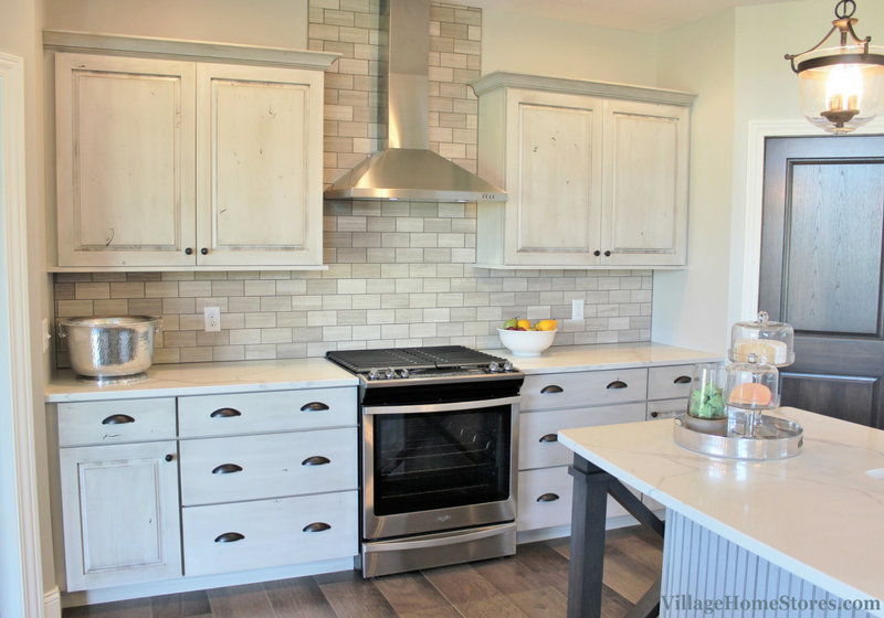 Painted White Drift kitchen with stainless appliances. Kitchen in a Bettendorf, IA with design and materials by Village Home Stores for Aspen Homes LLC. | VillageHomeStores.com