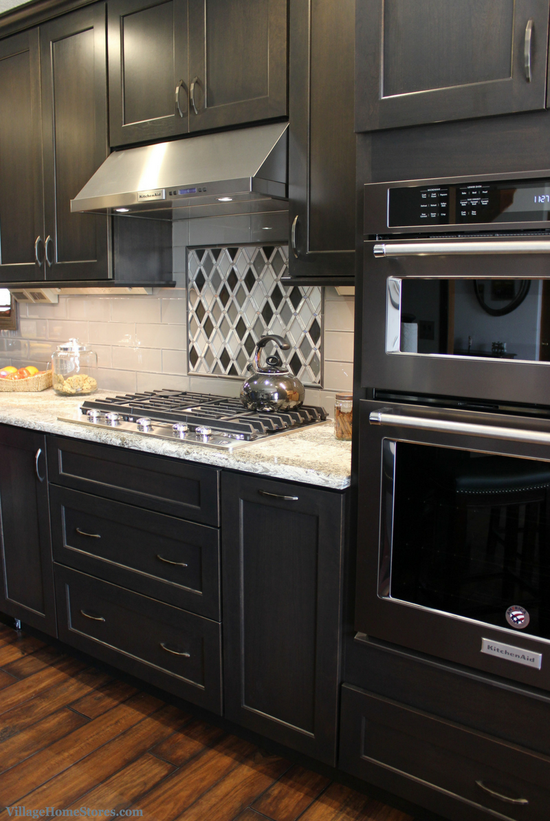 A Bettendorf, IA kitchen with KitchenAid Black Stainless and decorative metal tile above the cooktop. | VillageHomeStores.com