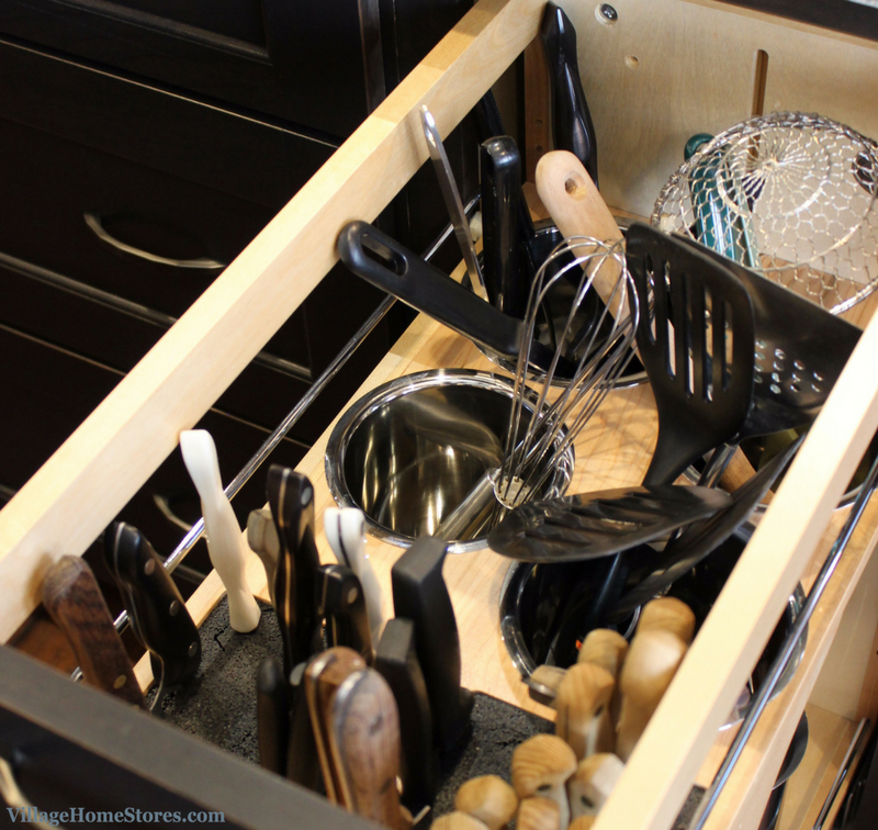 A Bettendorf, IA kitchen with DuraSupreme cabinetry including pull out utensil organizer. | VillageHomeStores.com