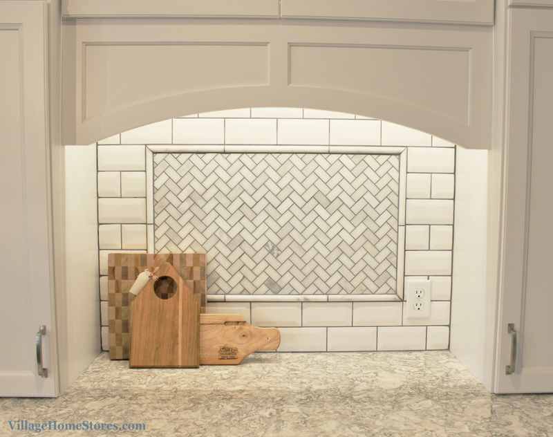 A Prophetstown, IL kitchen with beveled subway tile, herringbone marble inlay and LED lighting. | VillageHomeStores.com