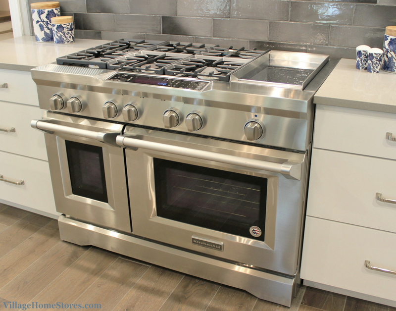 "Painted white cabinetry and KitchenAid appliances including 48"" wide gas range with griddle. 