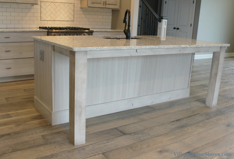 White Drift painted kitchen with island. Kitchen design by Village Home Stores. | VillageHomeStores.com