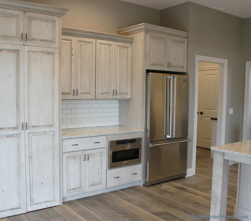White Drift painted kitchen with Viking Appliance package. Kitchen in a Bettendorf, IA with design and materials by Village Home Stores for Edgebrooke Homes. | VillageHomeStores.com