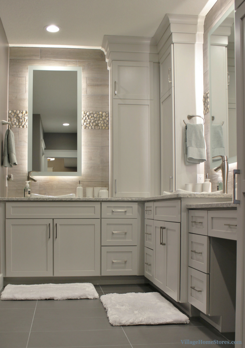 DuraSupreme cabinetry and custom backlit mirrors in Davenport bathroom. Remodeled from start to finish by Village Home Stores. | VillageHomeStores.com