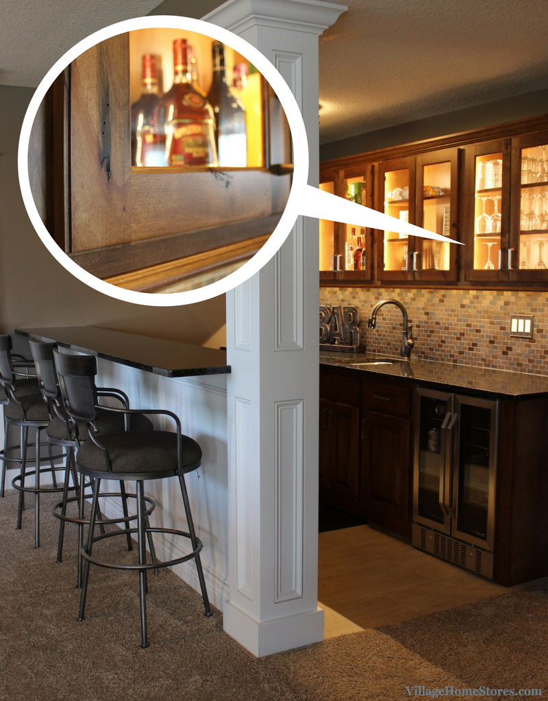 Koch Cabinets with lighted interior and glass inserts in Davenport Home Bar. | VillageHomeStores.com