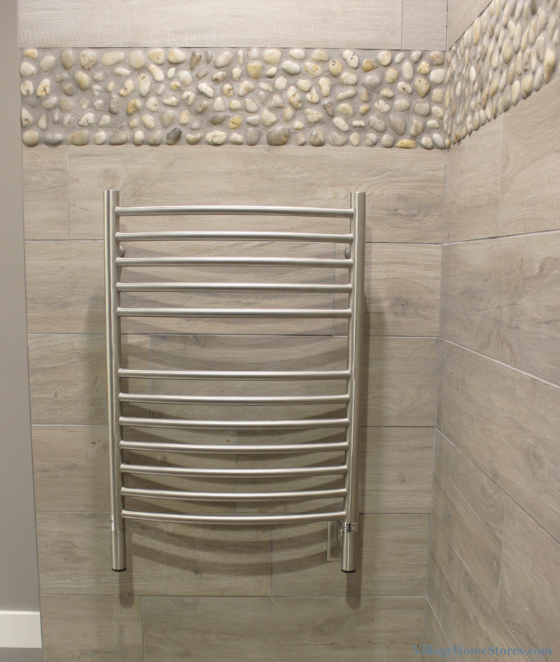 Davenport bathroom remodel with custom tiled shower, pebbled tile floor, and heated towel rack. | VillageHomeStores.com