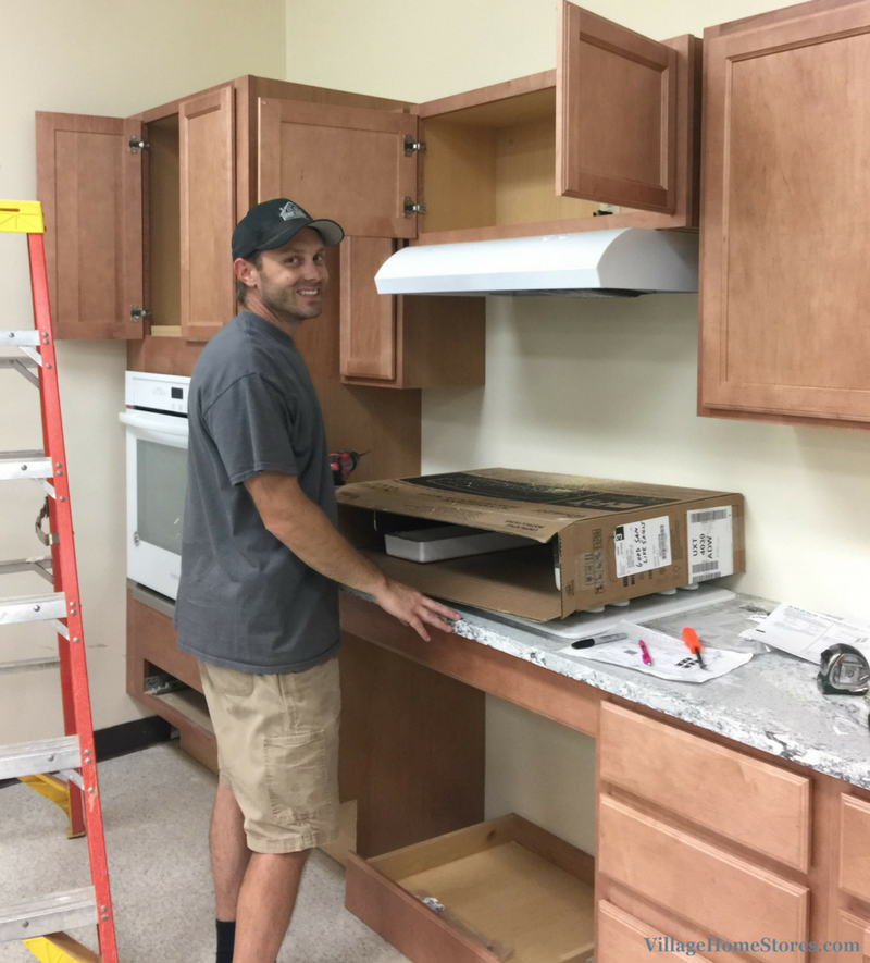 Village Home Stores installing new appliances in the Geneseo High School Lifeskills Lab. | VillageHomeStores.com