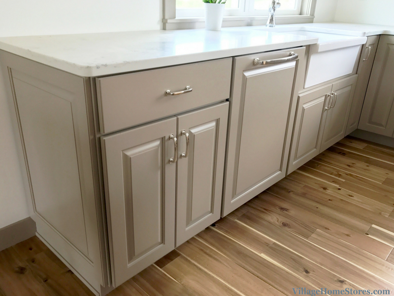 Painted light gray / taupe cabinets by Koch Cabinetry. | VillageHomeStores.com
