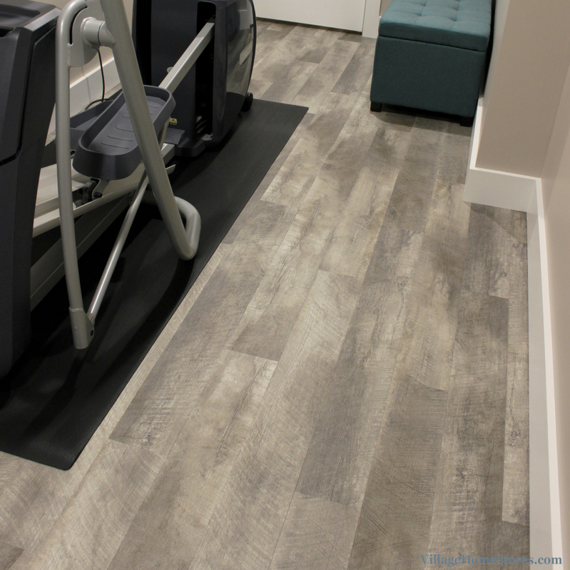 Basement remodel including new Home Gym with Luxury Vinyl Plan floors in a remodeled Davenport home. | VillageHomeStores.com