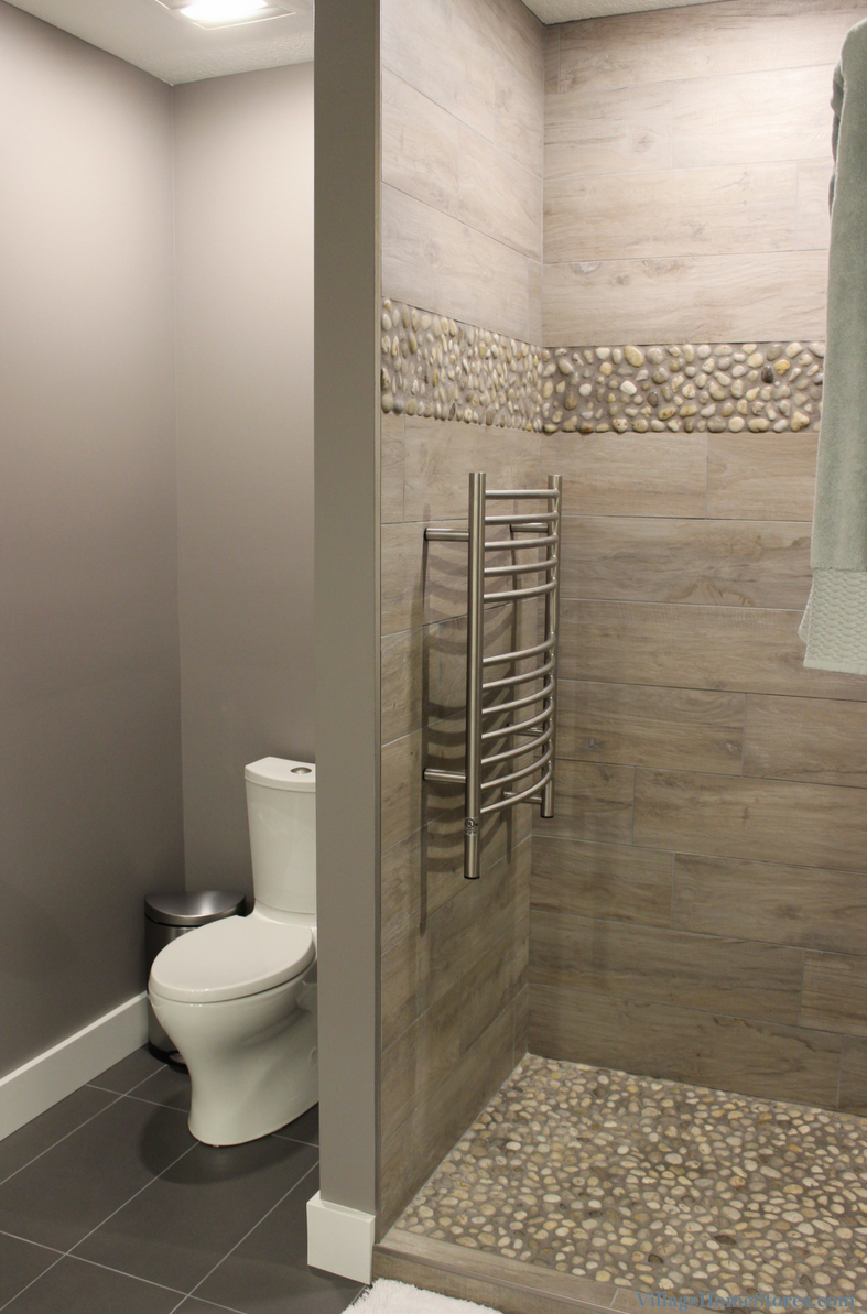 Davenport bathroom remodel with custom tiled shower with pebbled tile floor. | VillageHomeStores.com