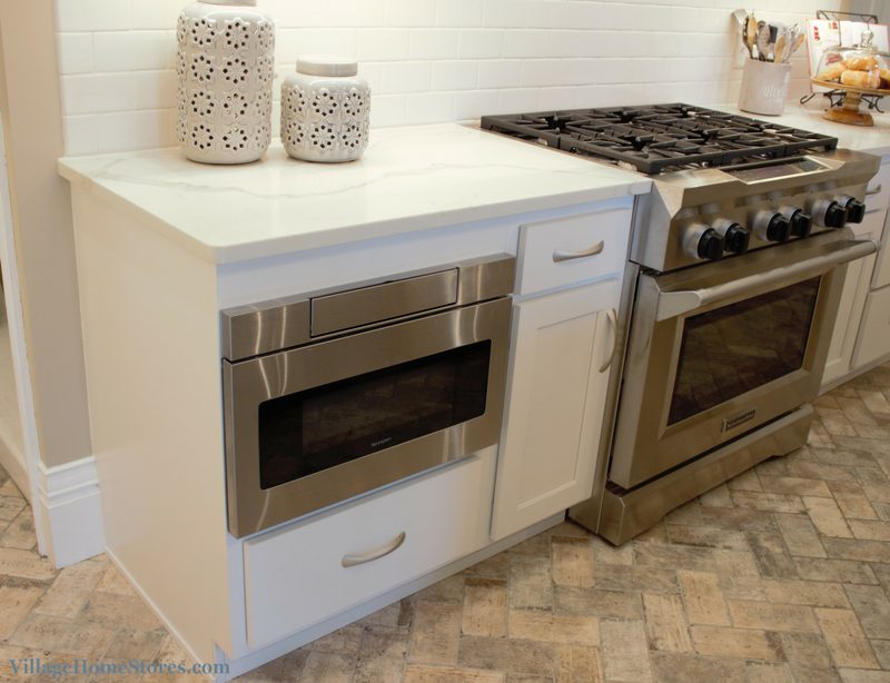 Stainless Steel appliances in a white painted kitchen. Sharp microwave drawer and KitchenAid pro gas range. | VillageHomeStores.com