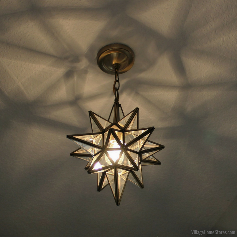 Unique brass star light from ELK hangs in an entryway. Lighting by Village Home Stores for Hazelwood Homes. | VillageHomeStores.com