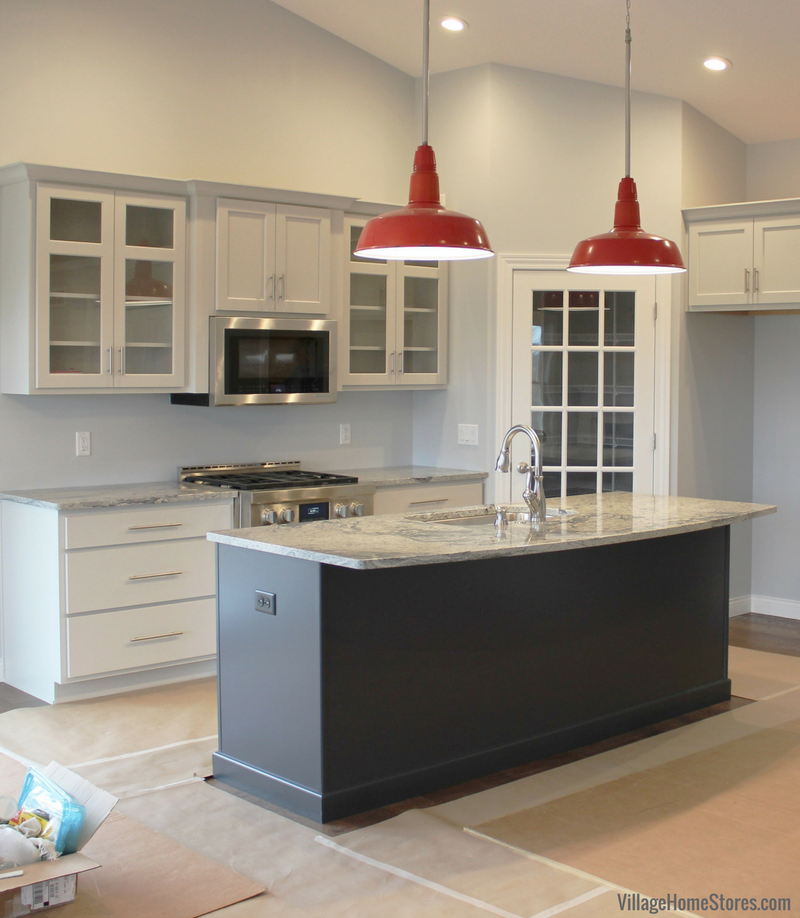 A Coal Valley, IL kitchen with Charcoal Blue painted cabinets. Design by Chris Robinson for Village Home Stores for Hazelwood Homes.