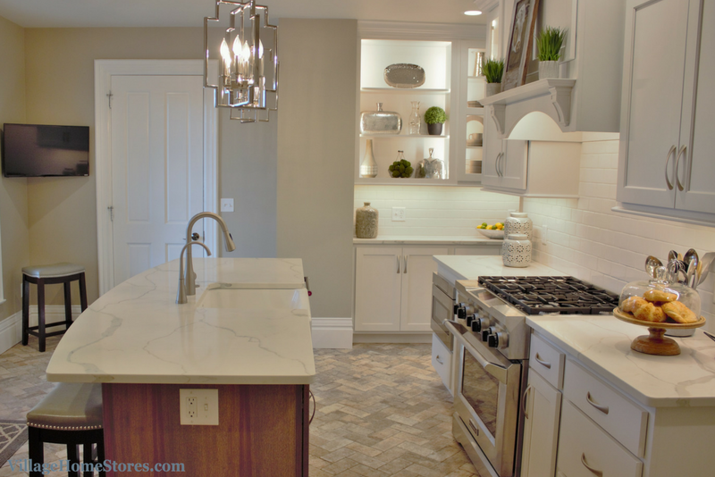 Kitchen remodeled from start to finish by Village Home Stores in a Historic Geneseo, IL home. Painted white cabinets, marble look quartz, and brick tiled flooring. | VillageHomeStores.com