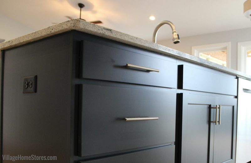 The Charcoal Blue painted finish from Koch Cabinetry. Design and materials by Village Home Stores for Hazelwood Homes. | VillageHomeStores.com