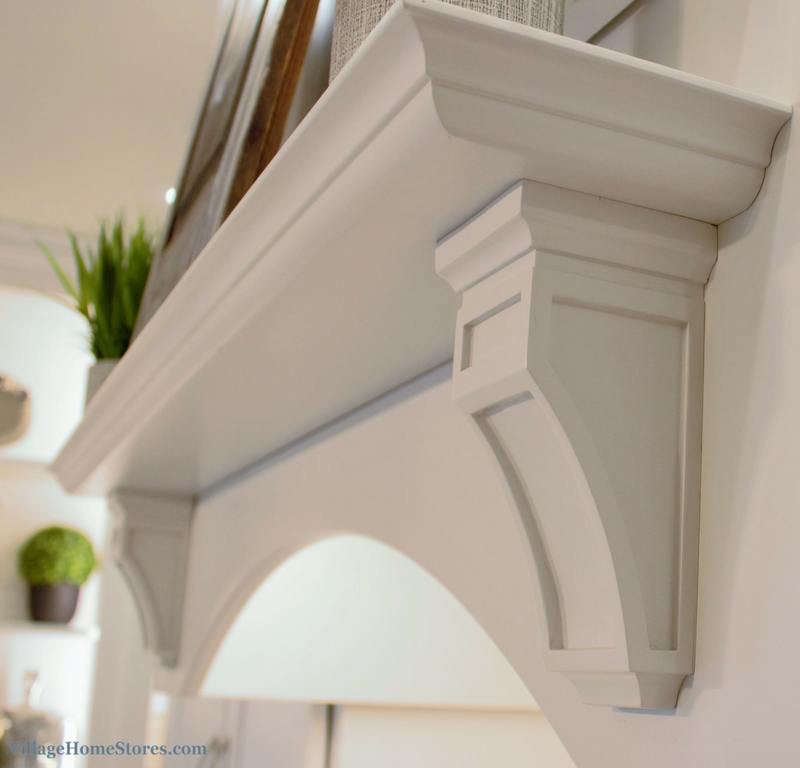 Wood hood mantle corbel detail in painted white finish. Kitchen remodel by Village Home Stores. | VillageHomeStores.com
