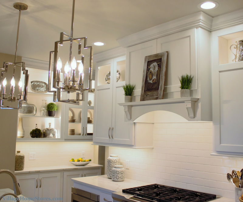 Painted white cabinets with a wood hood design. Kitchen remodeled in historic Geneseo home by Village Home Stores. | VillageHomeStores.com