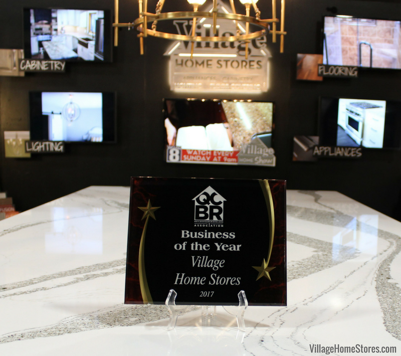 Our Business of the Year award from the Quad Cities Builders and Remodelers Association rests on Cambria Annicca quartz in our 2018 QCBR Home Show booth. | Village Home Stores