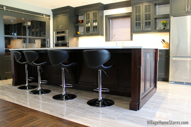 DuraSupreme Cabinetry island in cherry wood and Chestnut stain featured in this Quad Cities area kitchen remodel from Village Home Stores. | VillageHomeStores.com