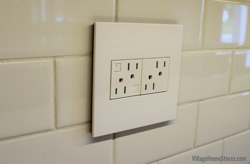 Unique Adorne switches and outlets and White subway tile featured in this Quad Cities area kitchen remodel from Village Home Stores. | VillageHomeStores.com