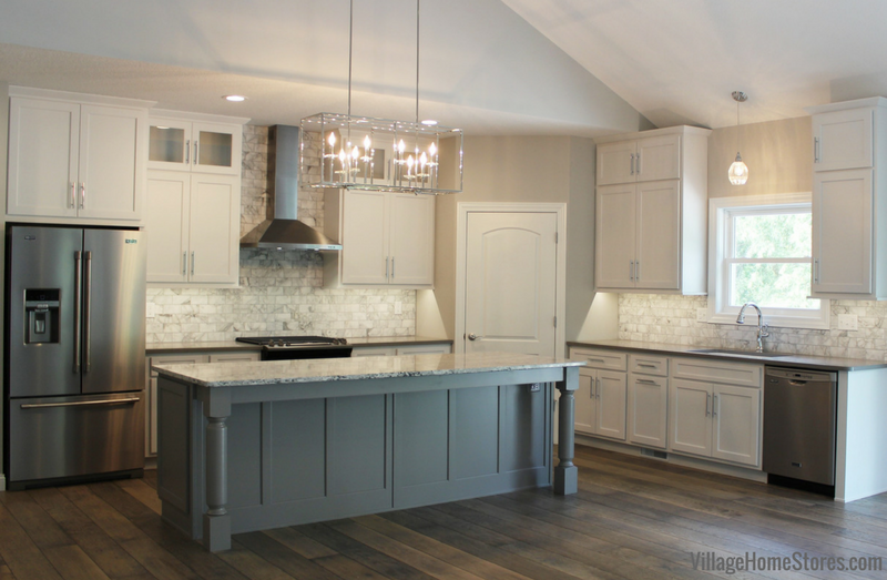 A Moline, IL kitchen with white and gray painted cabinets and quartz tops. Design by Chris Robinson, Village Home Stores for Hazelwood Homes. | VillageHomeStores.com