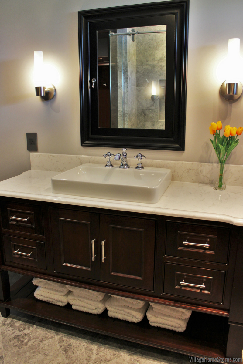 Furniture style vanity by DuraSupreme Cabinetry. Design and materials by Village Home Stores. | VillageHomeStores.com