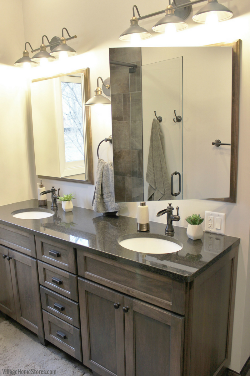 Bathroom remodel in Moline, IL with gray stained cabinets and framed medicine cabinets | VillageHomeStores.com