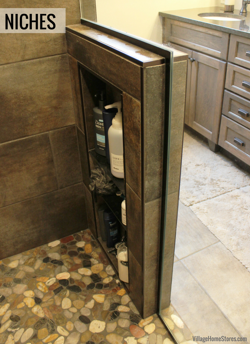 Tiled shower in a remodeled Moline, IL home with custom tiled niche shelf. | VillageHomeStores.com