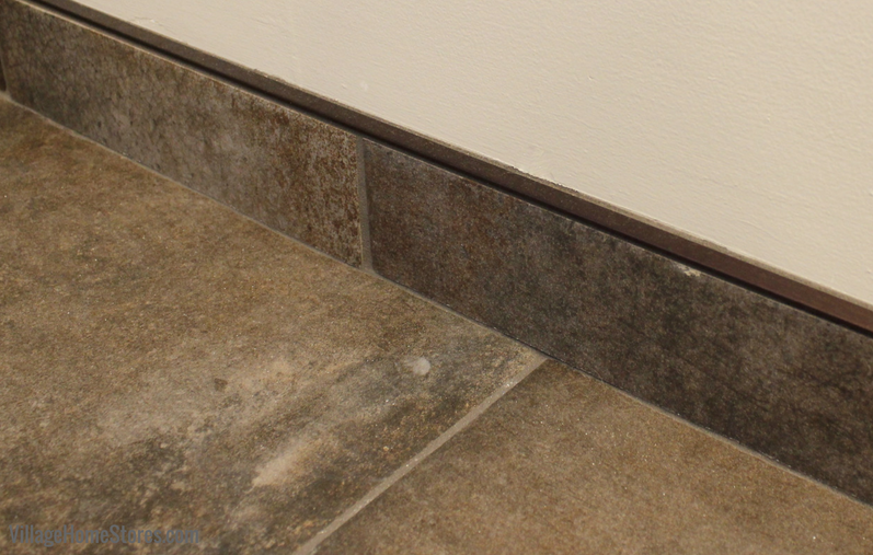 Bathroom remodel in Moline, IL with tiled baseboard areas and schluter strip. | VillageHomeStores.com