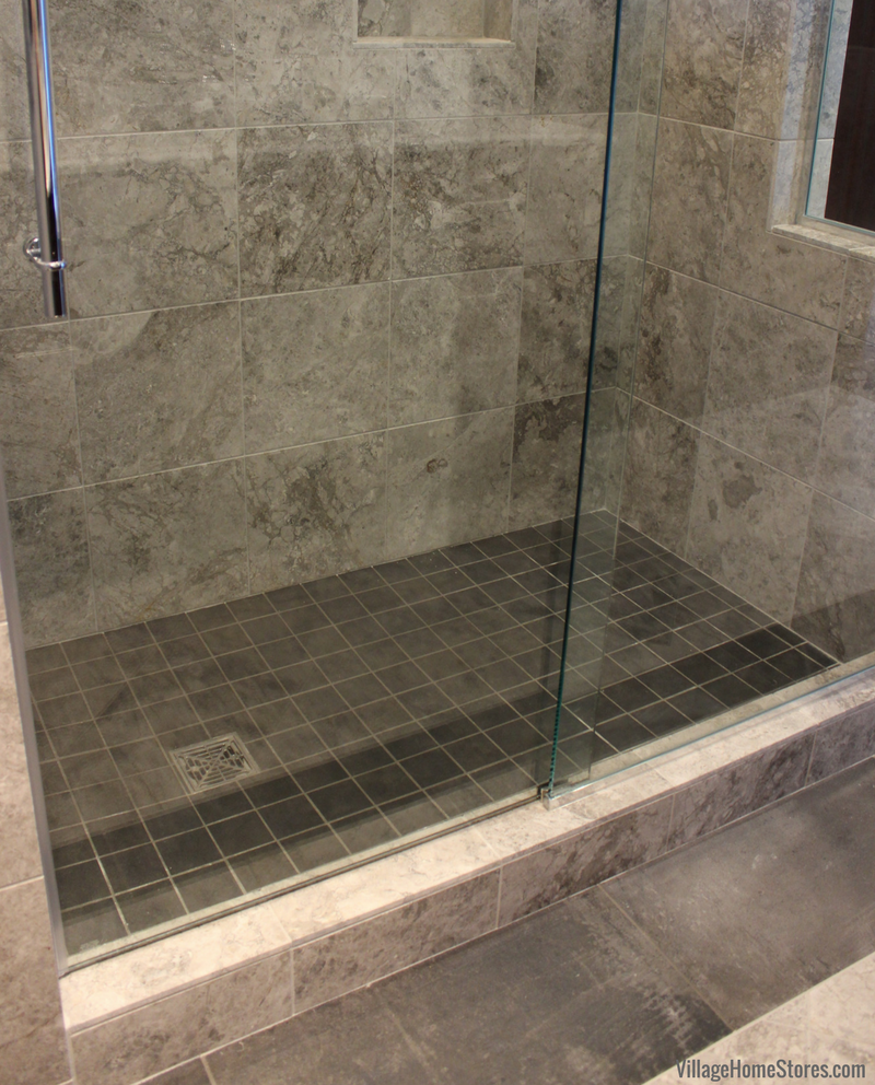 Custom tiled shower in a Quad Cities area bathroom. Design and materials by Village Home Stores. | VillageHomeStores.com