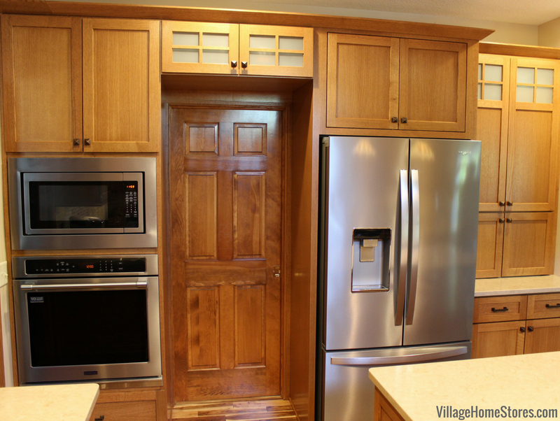 Quartersawn Oak cabinetry by Dura Supreme paired with an appliance package from Village Home Stores. Kitchen remodeled from start to finish by Village Home Stores. | VillageHomeStores.com
