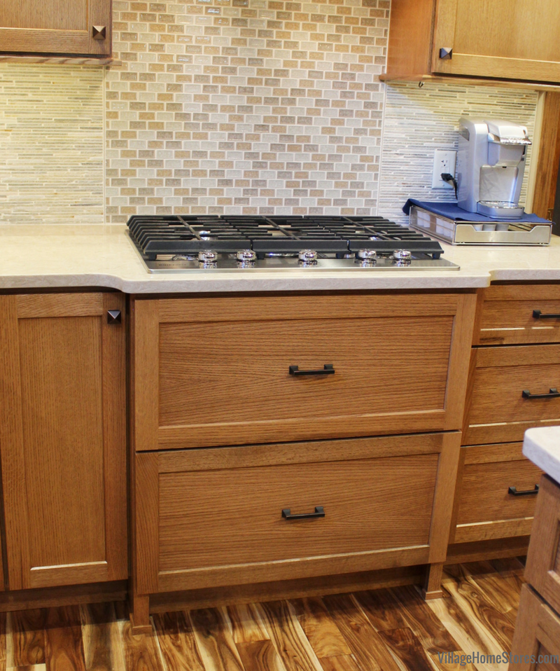 Quartersawn Oak cabinetry by Dura Supreme with a gas 5-burner cooktop. | VillageHomeStores.com