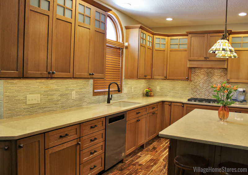 Quartersawn Oak cabinetry by Dura Supreme paired with a natural Acacia floor, natural stone tile, and engineered quartz counters. | VillageHomeStores.com