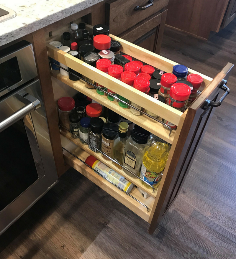 Pullout spice rack cabinet in a Princeton, IL kitchen. Kitchen remodeled from start to finish by Village Home Stores. | VillageHomeStores.com