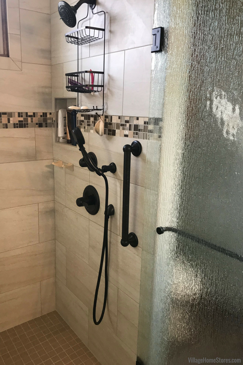 Custom tile shower with grab bar in a remodeled Princeton, IL home. Design, materials, and remodel by Village Home Stores. | VillageHomeStores.com