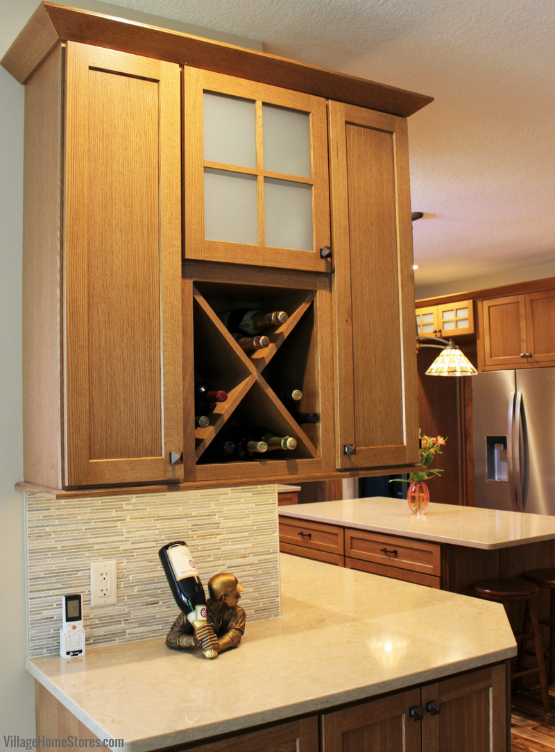 Bettendorf Iowa wine storage cabinet in a Quartersawn Oak kitchen with cabinetry by Dura Supreme. Kitchen remodeled from start to finish by Village Home Stores. | VillageHomeStores.com