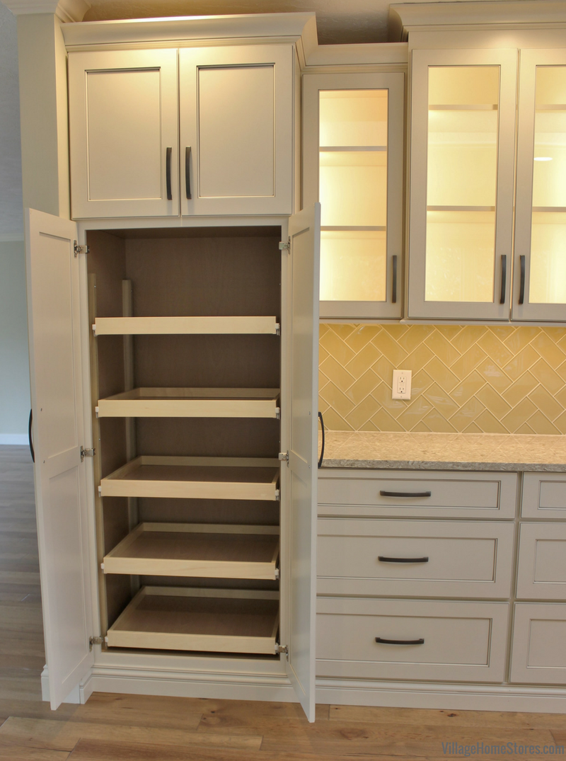 Tall pantry cabinet with slideout shelves in a remodeled Bettendorf Iowa home. | VillageHomeStores.com